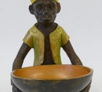 Hand painted bronzed resin monkey holding bowl wearing hat and moss green jacket
