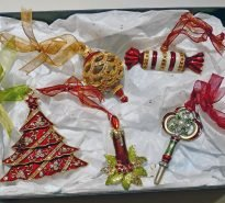 Beautiful gift box containing enamelled hanging Christmas decorations
